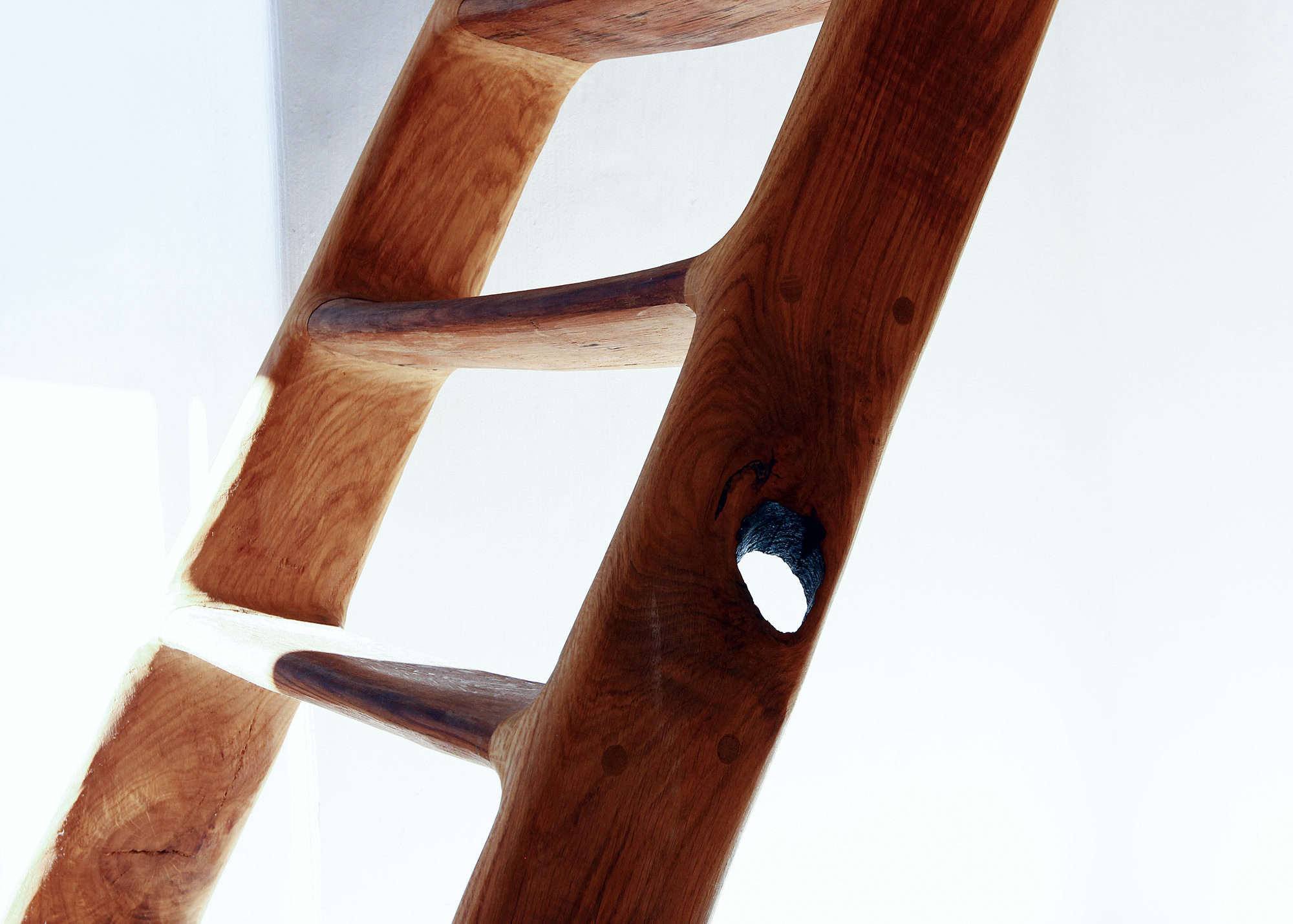 Valentin designed and built the stair usingreclaimed oak wine barrels, which he carved to achieve a curved shape.