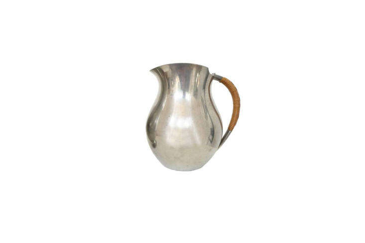The Vintage Just Andersen Danish Pewter Pitchercan be sourced from Chairish and other online vintage dealers.