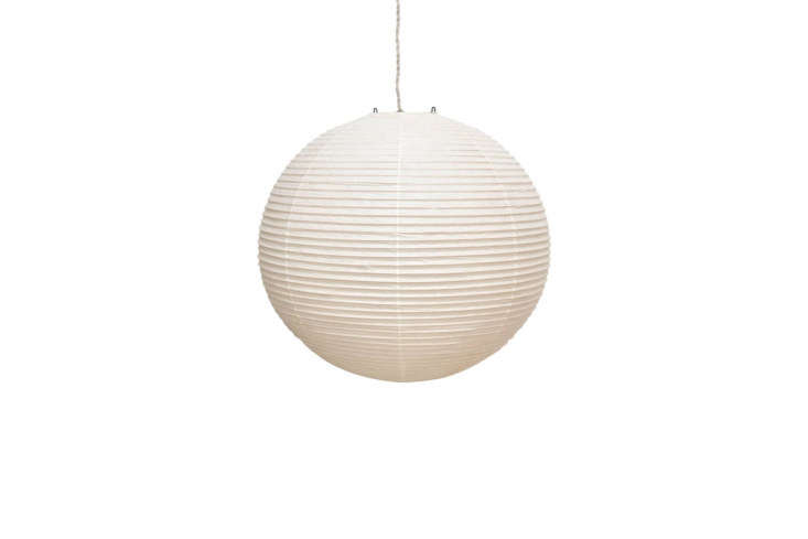 The pendant hanging above the kitchen is the Noguchi Akari Pendant Lamp 55A; $305 at Modern Nest.