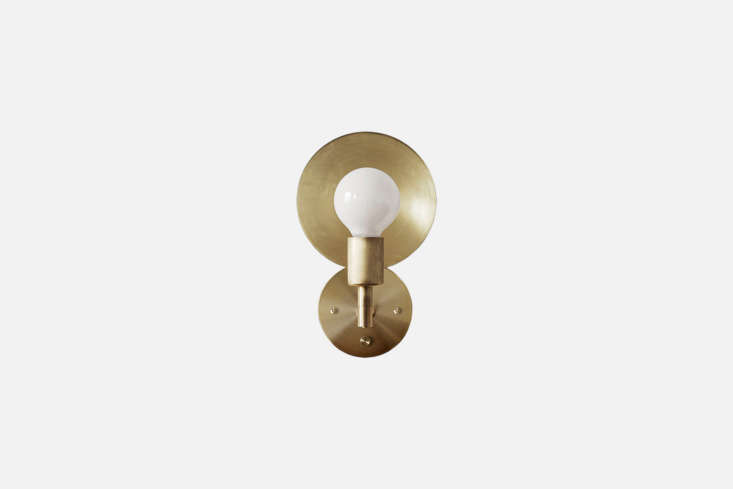 Steal This Look A Polychromatic Dream Kitchen in Hackney London A row of brass Workstead Orbit Sconces, \$985 each, run the length of the kitchen/dining room.