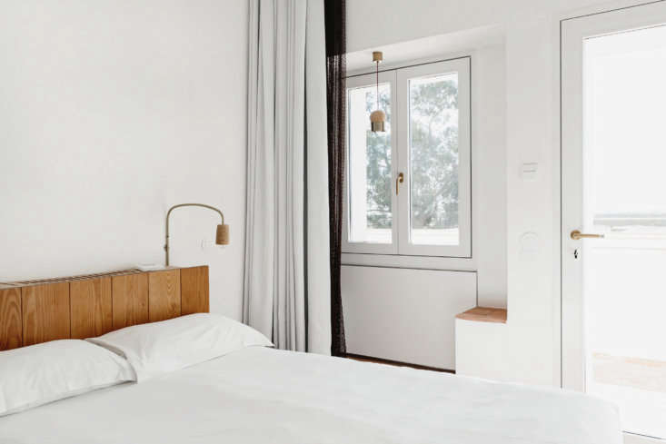 the bedroom lights, sconces, and pendants are made of cork and brass by the hom 22