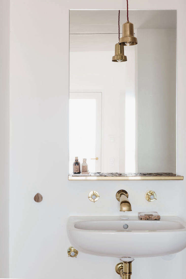 the faucets, as before, are from bruma. the brass pendant light is by the home  25