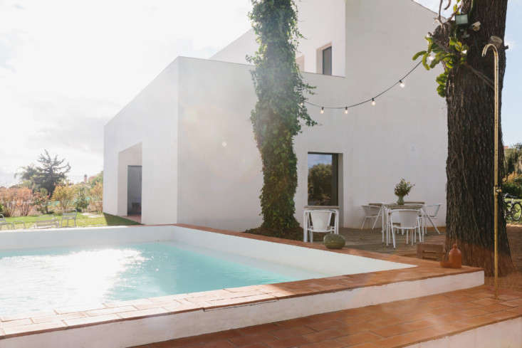 the pool surround is made of terracotta tile. 30