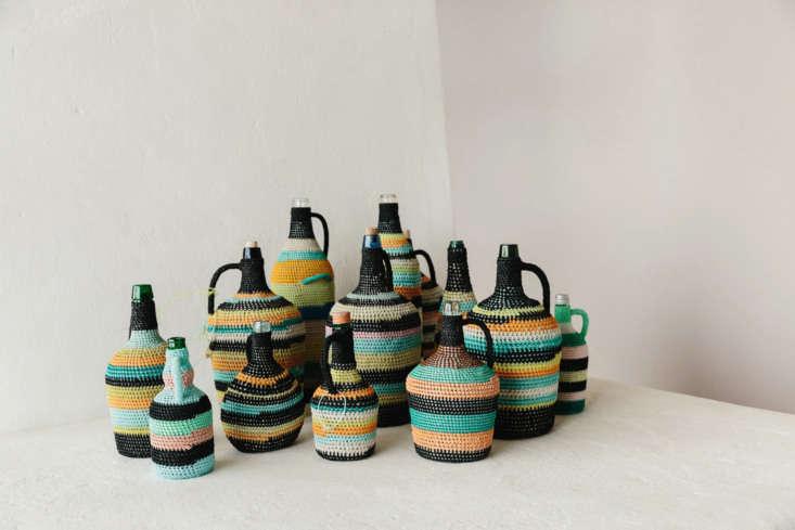 glass bottles are encased in colorful crochet, casa modesta offers workshops on 13