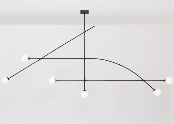 The blackened brass Tempo Chandelier is by Atelier de Troupe: See Handmade in LA. It comes in an eight-foot size (shown) for $loading=