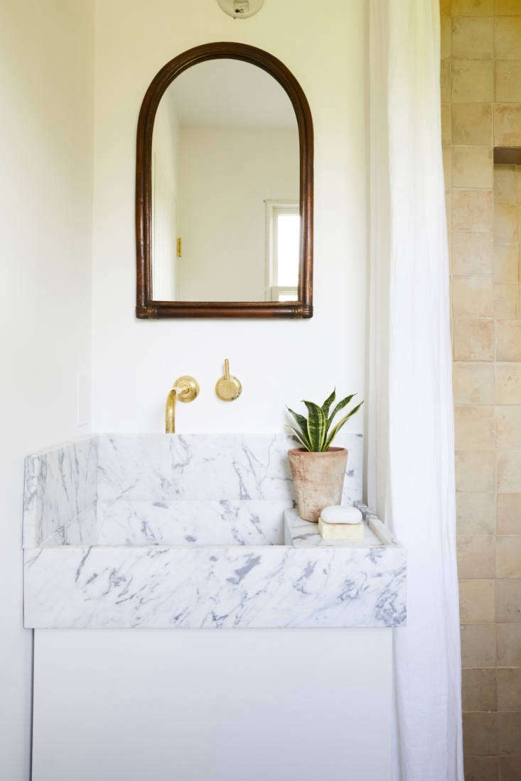 the bathroom, with a compact marble sink and tiles from cle tile. 17