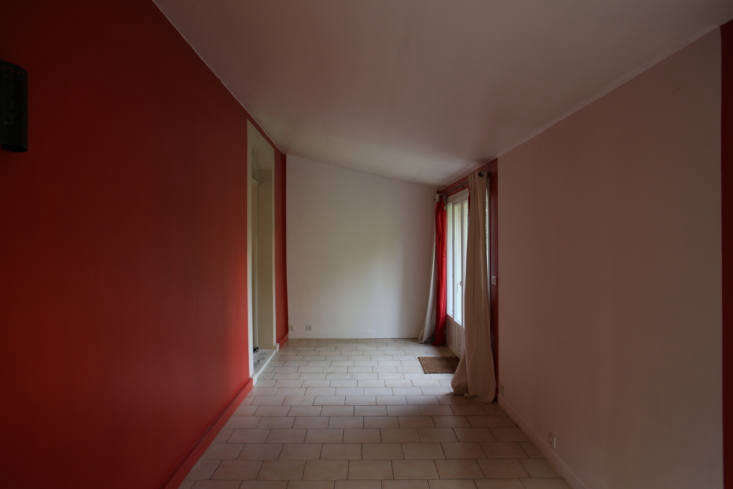The extension had been a dark, awkwardly shaped dining room with an accent wall in tomato red.