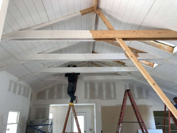 drop ceilings were removed and exposed beams painted white. 21