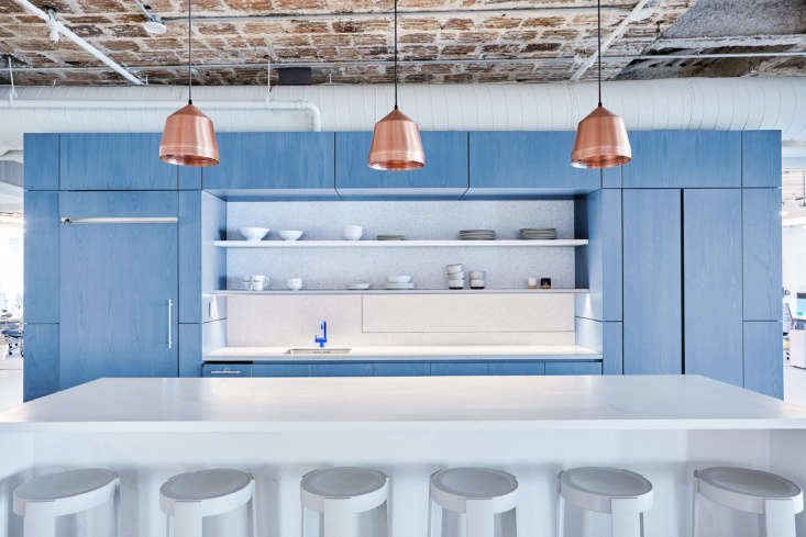 the office palette echoes the company&#8\2\17;s blue and white branding, wh 13