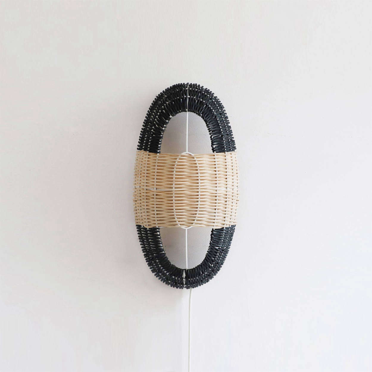 The Arc Small Lamp in Black and Natural Rattan is €5.