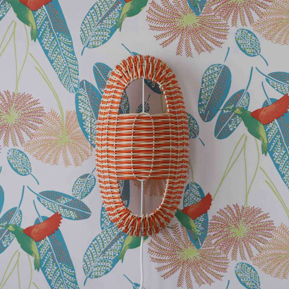 the arc small lamp in coral and natural rattan on a white lacquered frame is � 17