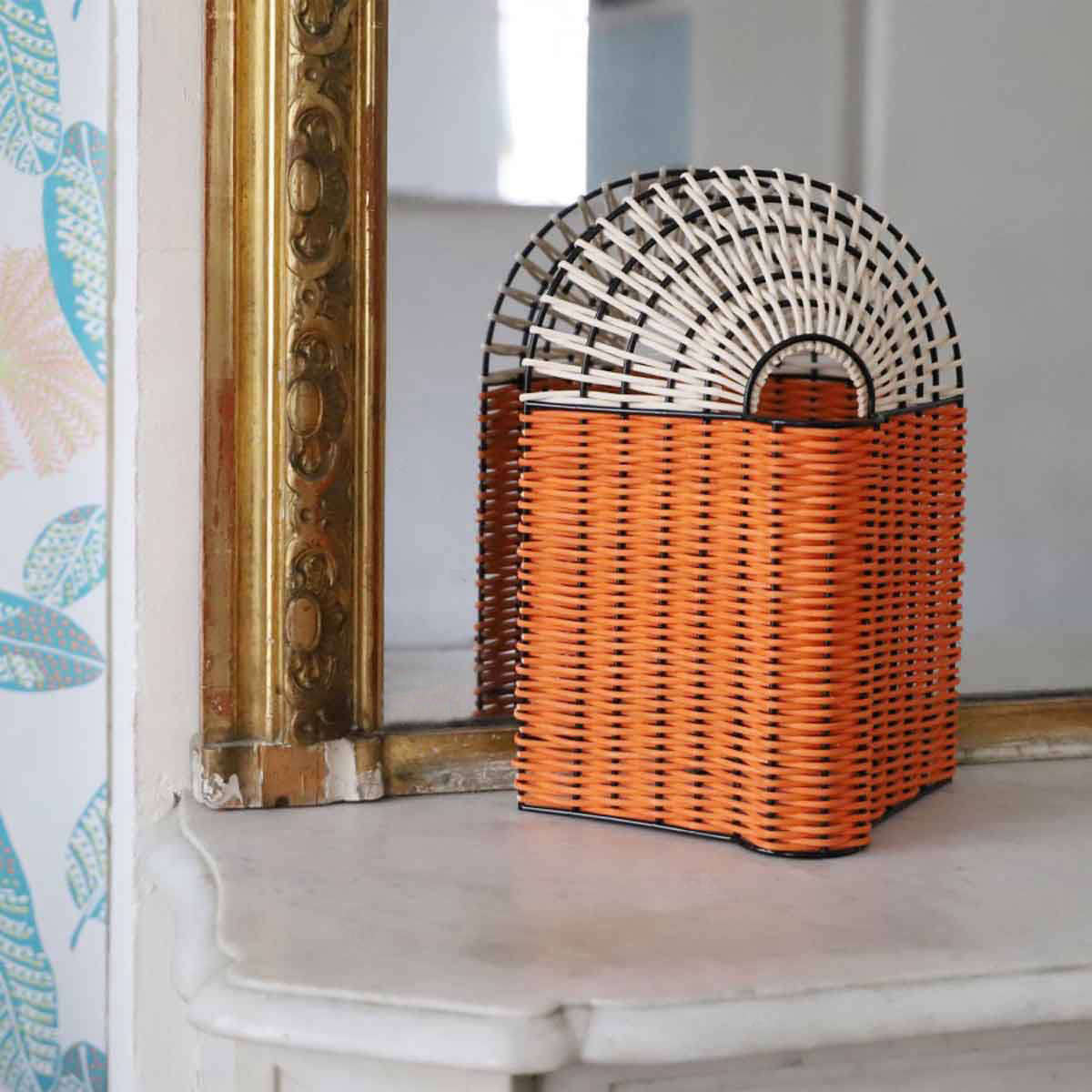The Paon Small Lamp in Coral and Natural Rattan is €9.