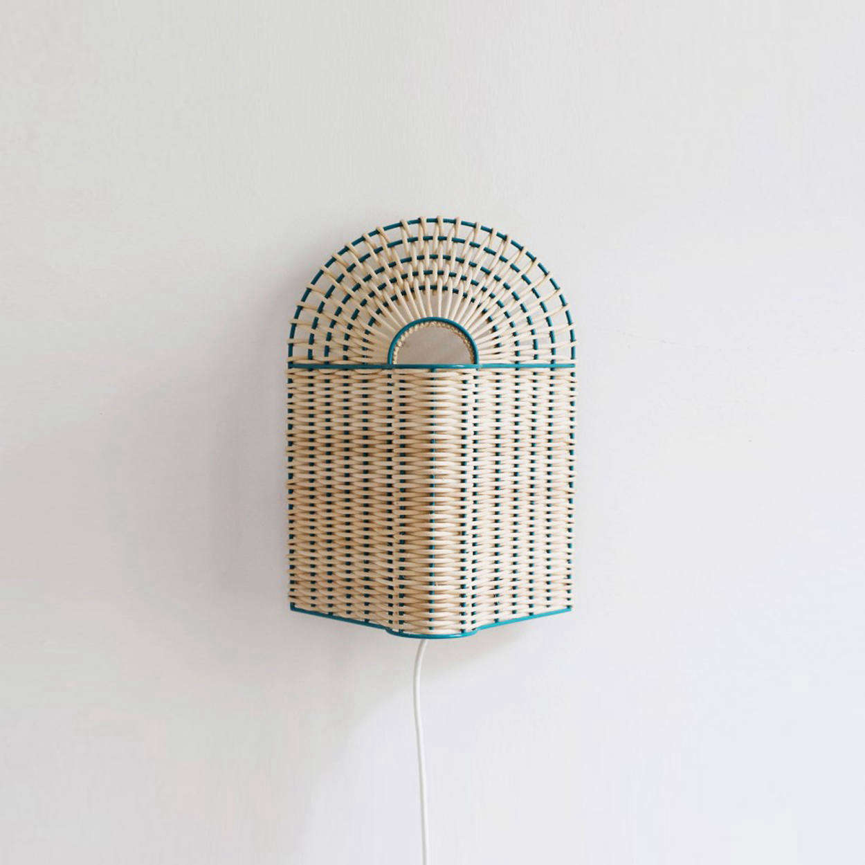The Paon Small Lamp in Natural Rattan with green lacquered metal is €9.