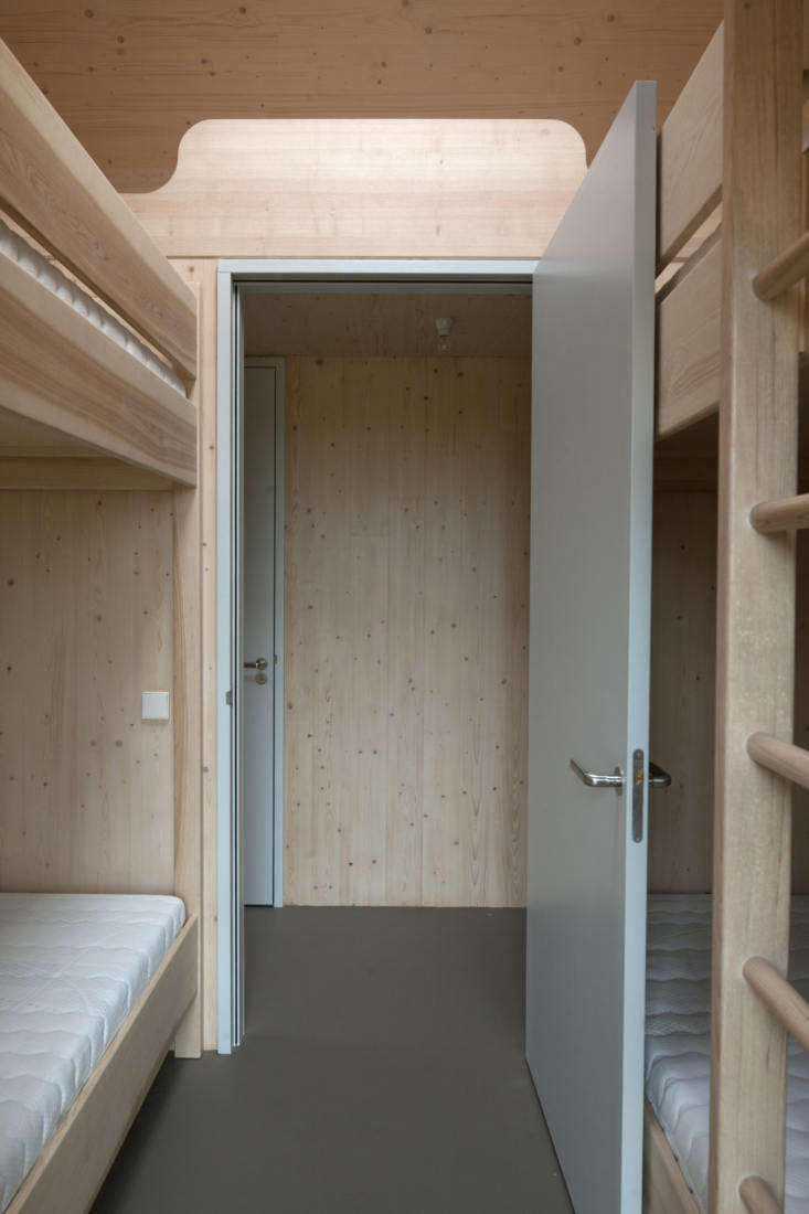 In designing two children's bedrooms, the architects were inspired by train compartment bunk beds.
