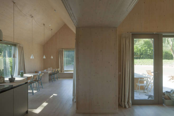 The interior walls are cross-laminated timber finished with a transparent whitewash varnish to allow the wood grain to show. The wood floors are ash.