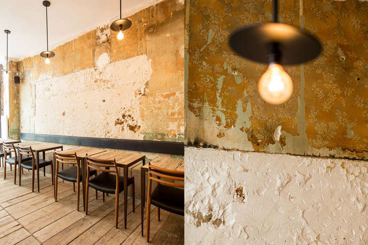 The designers stripped away layers of wallpaper to reveal the original walls.