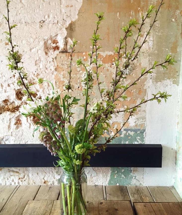 An informal flower arrangement in a recycled jar.
