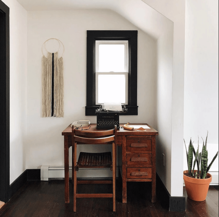A desk and vintage typewriter in the Writer Studio guest room.