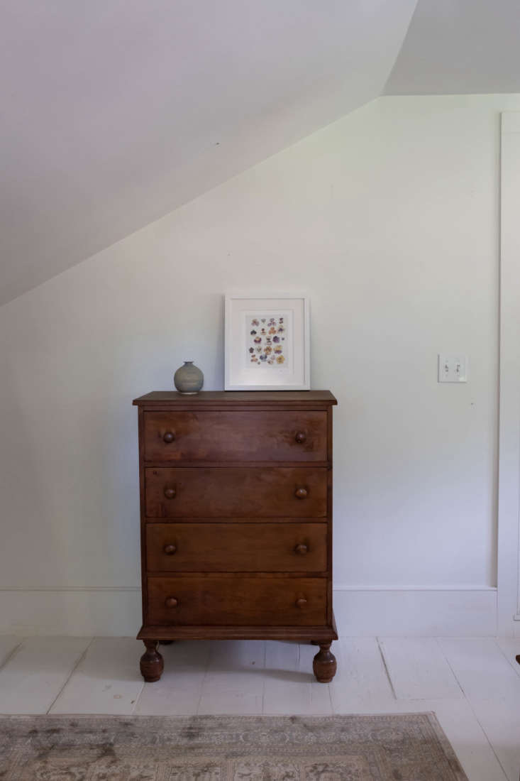 A dresser with one of Dealtry's own watercolors. The floors were already painted white when the couple moved in—a risk they say they wouldn&#8