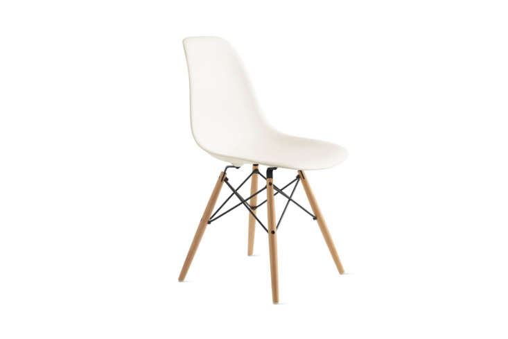 The Eames Molded Plastic Dowel Leg Side Chair with a white shell and maple legs starts at $495 from Design Within Reach.
