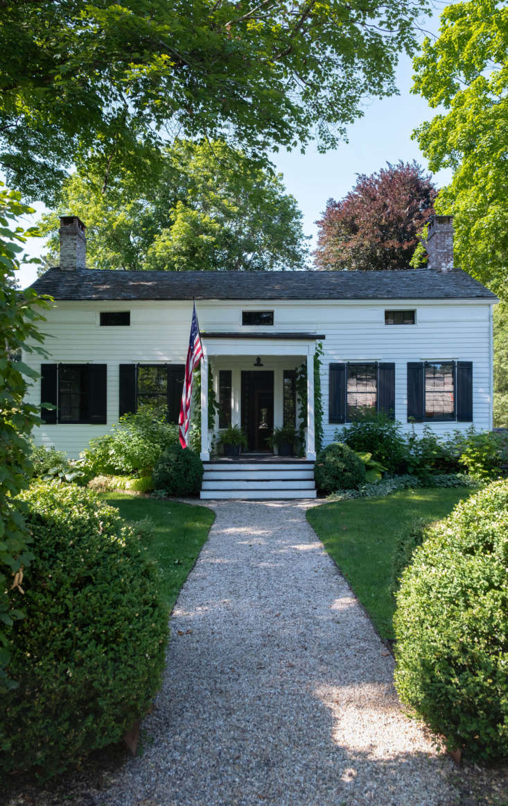 The house dates to 30 and sits behind a neat, square row of hedges in Claverack, a few minutes&#8