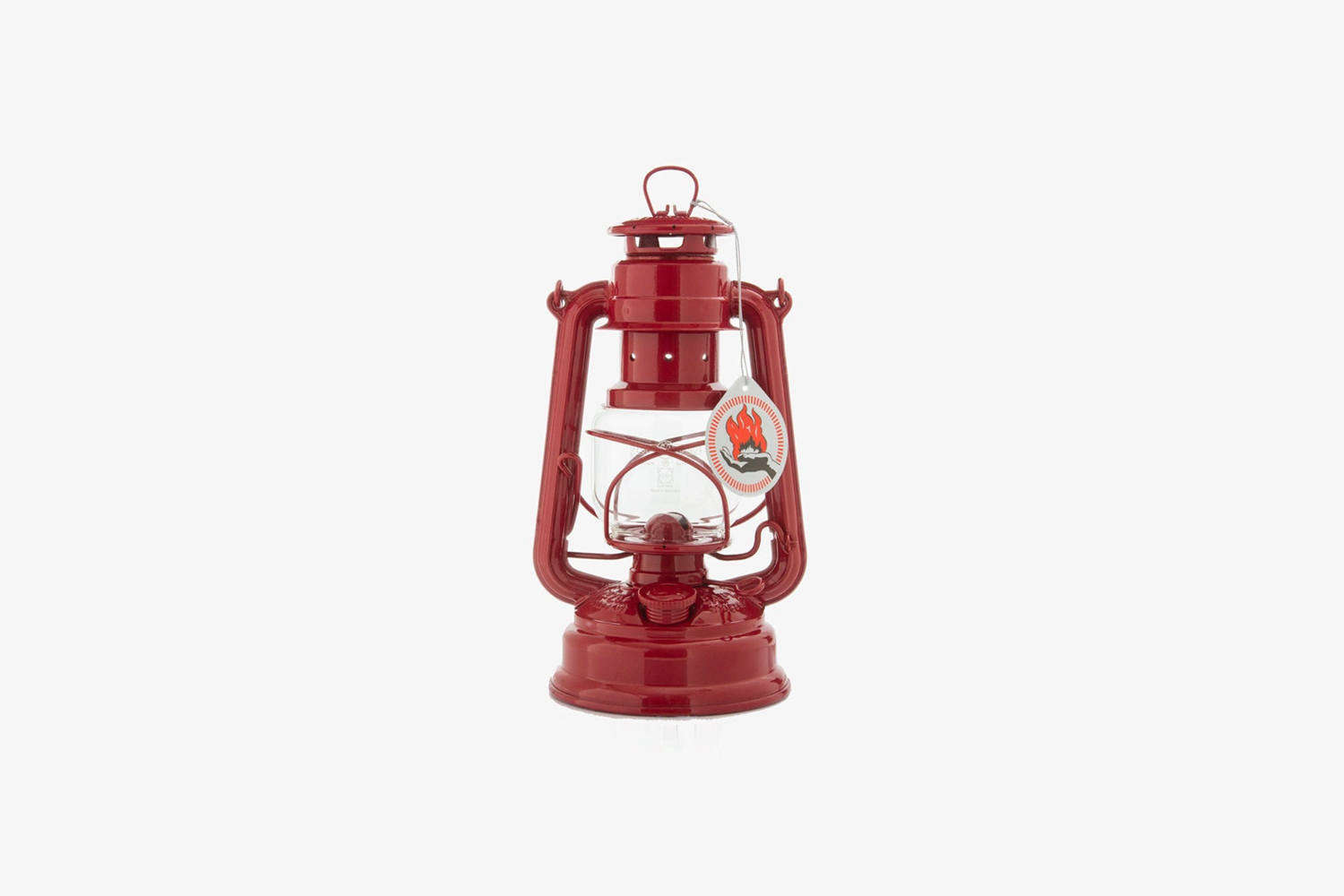 Steal This Look A Stylish Camp Kitchen in a Plywood Summer Cabin The Feuerhand Storm Lantern Ruby Red is available at Home Camp in Australia for \$69.