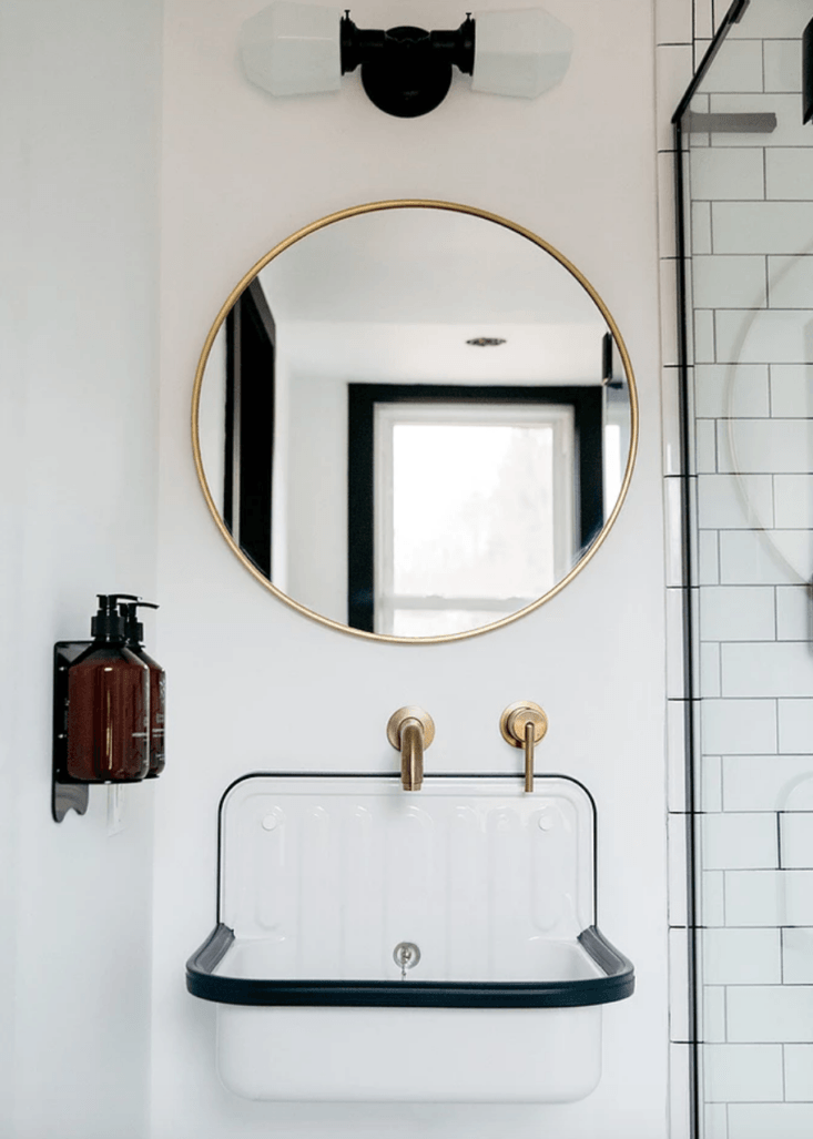 The bathrooms are fitted with hard-wearing enamel sinks (read more about them in Design Sleuth: The Alape Bucket Sink from Germany) and brass faucets.