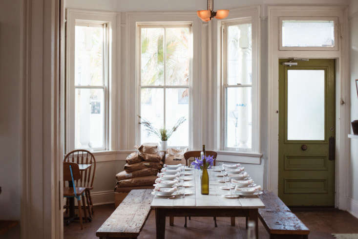 The farmhouse benches and tables were handcrafted by Matthew Holdren, a New Orleans furniture designer, based on vintage pieces Martin loved.Sacks of flour by the window aren't just for decoration: Levee Baking Co. uses it for baking each week.