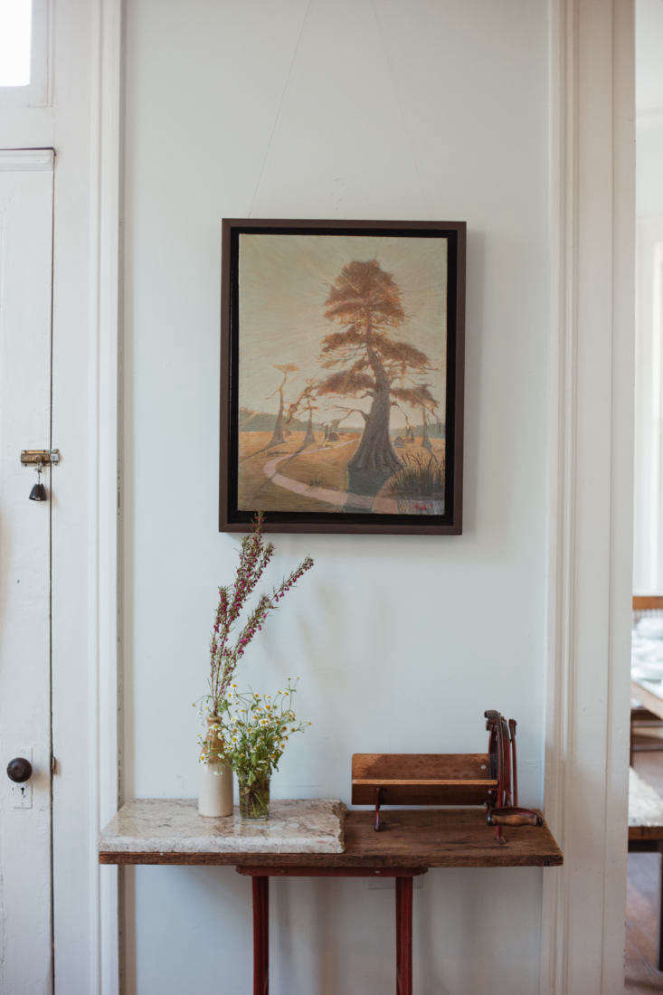 A vignette on a side table. Leslie Martin, the artist, may spend up to a year on a single painting like this one.