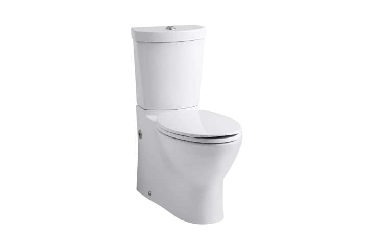 Izabella installed the sleek high-efficiency Kohler Persuade Toilet in her guest bath. The two-piece vitreous china toilet with an elongated bowl features a top-mounted flushing button that offers the choice of 0.8 or loading=