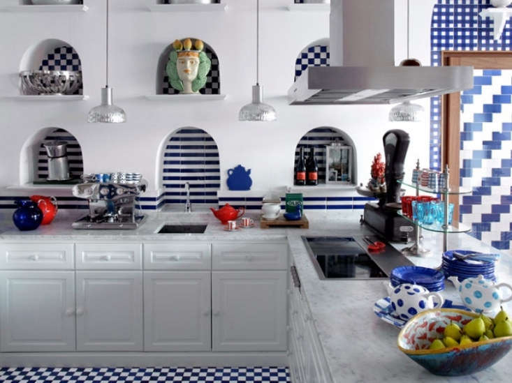 The kitchen is outfitted in a mix of striped, checkerboard, and zigzag tiles.
