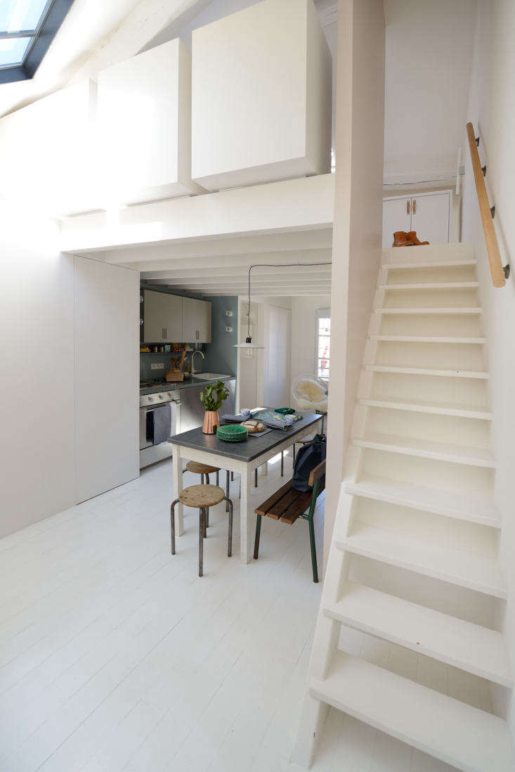 A ladder-like tapered stair leads to the sleeping loft.
