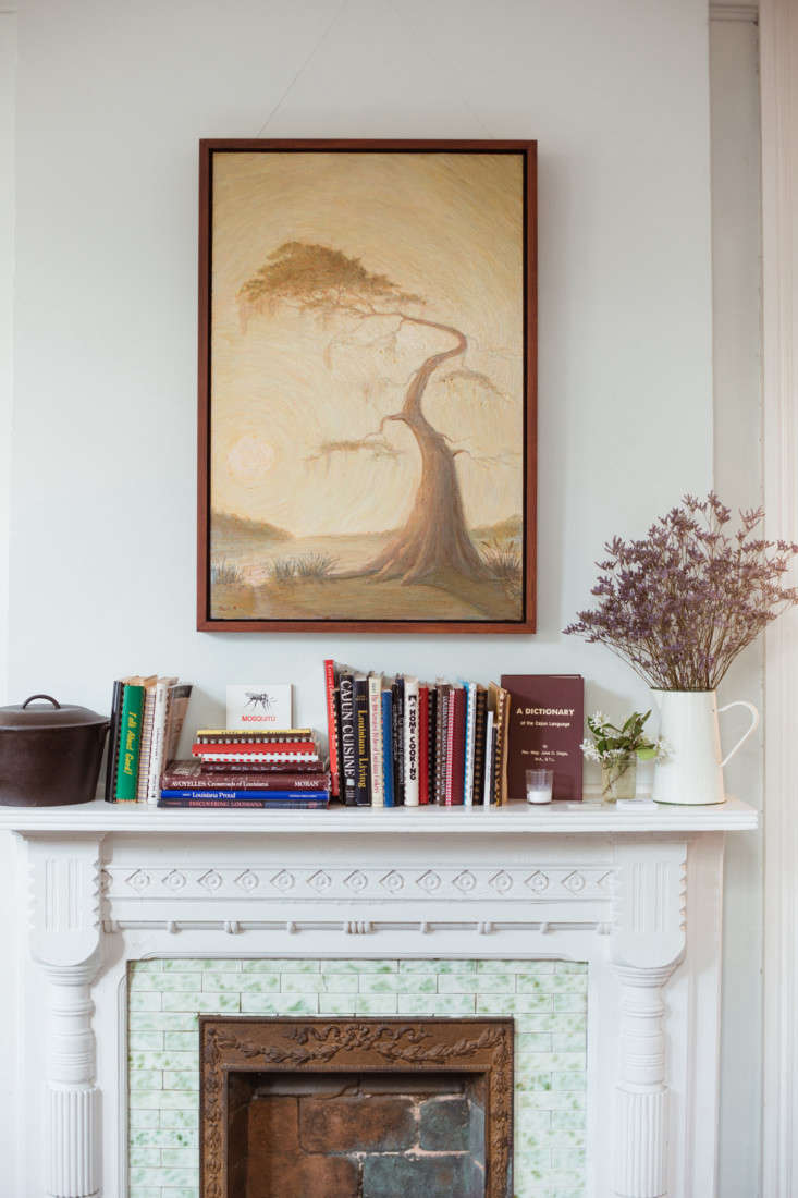 """""""There are two mantles and I call them our shrines,"""" says Martin. """"Mosquito Supper Club has one and Levee has one. My shrine is full of old Cajun spiral-bound cookbooks that Ellen  collects, and other things we love.&#8"""