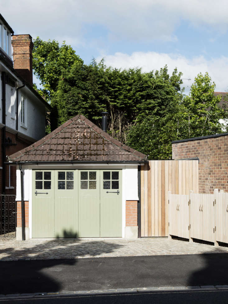 located in hampstead, in north london, the garage stands alongside a \1905 hous 9