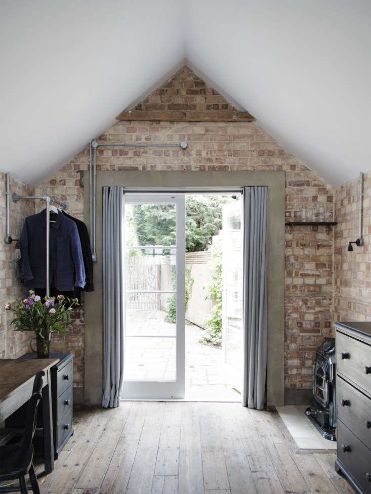 in the back of the garage, new curtained french doors serve as the entrance: a  12