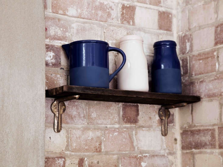 the wall shelf next to the french doors rests on little chap l brackets. the ce 15