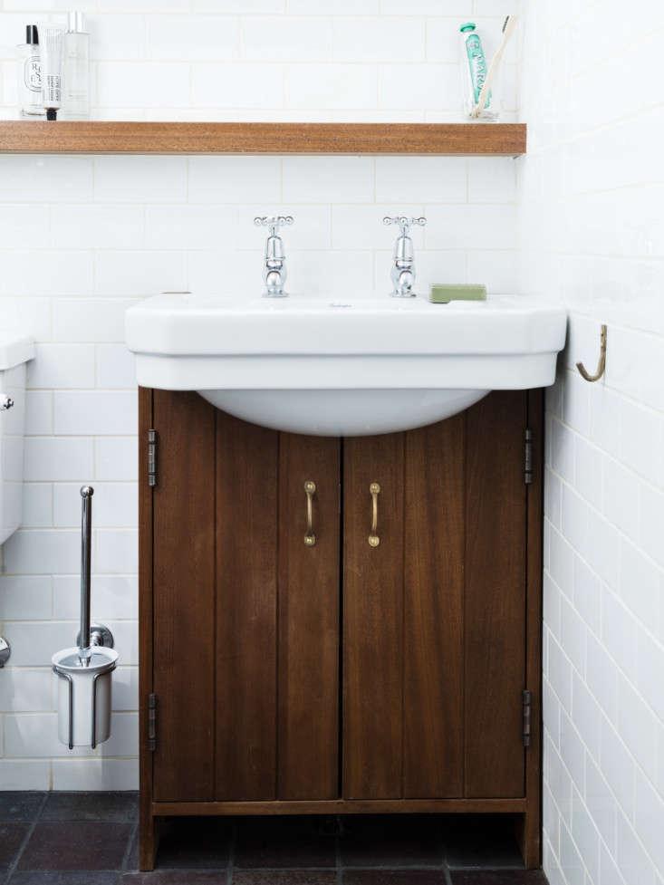 the custom under sink cabinet is also teak with bronze gareth pull handles. not 17
