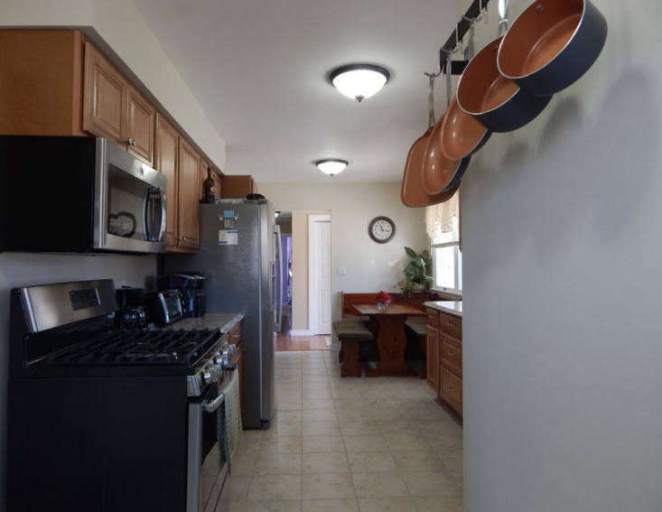 pre renovation,the house was dated, low ceilinged, and dark, with a breakfast 20