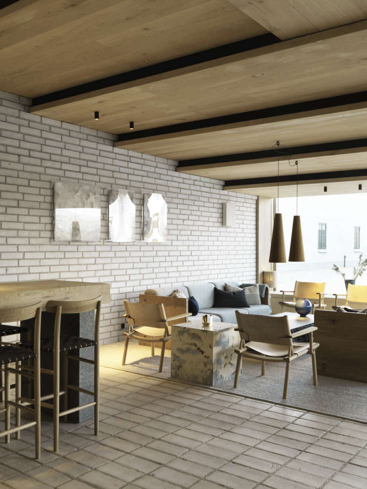 The lounge is designed with custom furniture from Thulstrup and designer Ragnhild Hjalmarsdóttir Højgaard, among Scandinavian classics.