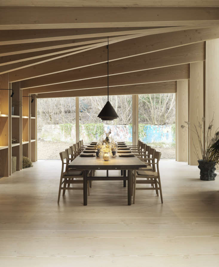 The private dining room is designed with Dinesen Douglas, a long oak table by Brdr. Krüger, and pendant lights made of a bio-composite pressed seaweed by Jonas Edvard. The room is designed to resemble Redzepi's own home, with his collection of ceramics and cooking tools on display. (See Redzepi&#8