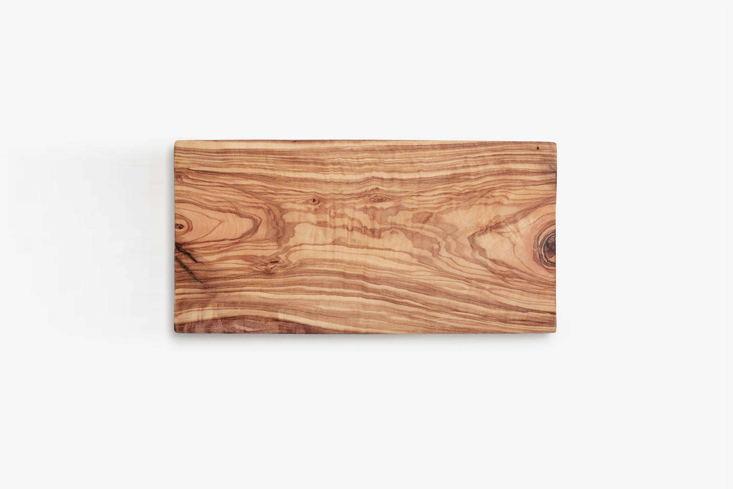 Steal This Look A Stylish Camp Kitchen in a Plywood Summer Cabin The Olivewood Rectangle Cutting Board is \$40 at ABC Carpet & Home.