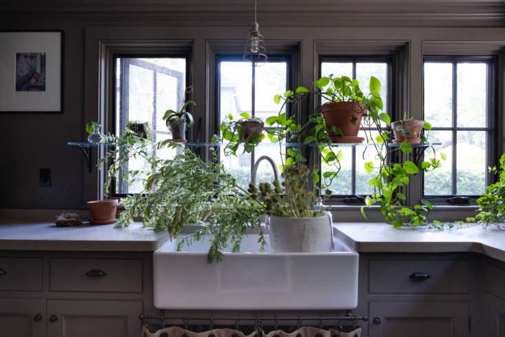 A corner room with small casement windows serves as a potting area for planting and arranging flowers. The room also serves as Barry's office.