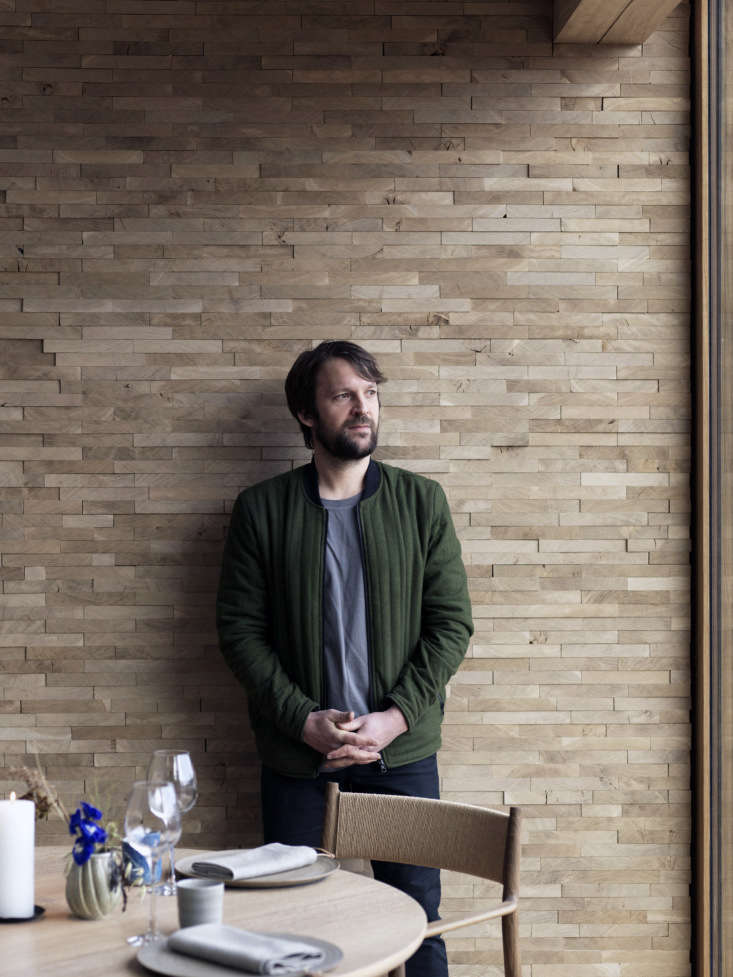 Redzepi in the new dining room. On the tables are glassware by artist Nina Nørgaard and ceramics by Christine Rudolph. Photograph by Jason Loucas, courtesy of Dinesen.