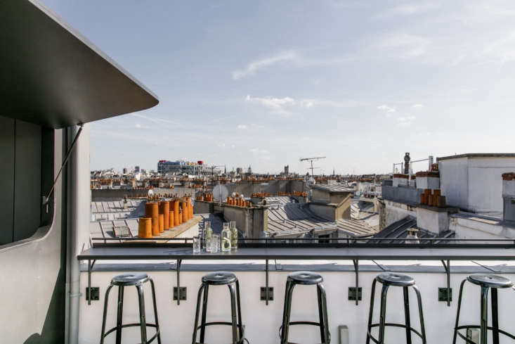 The small rooftop bar offers views of the city.