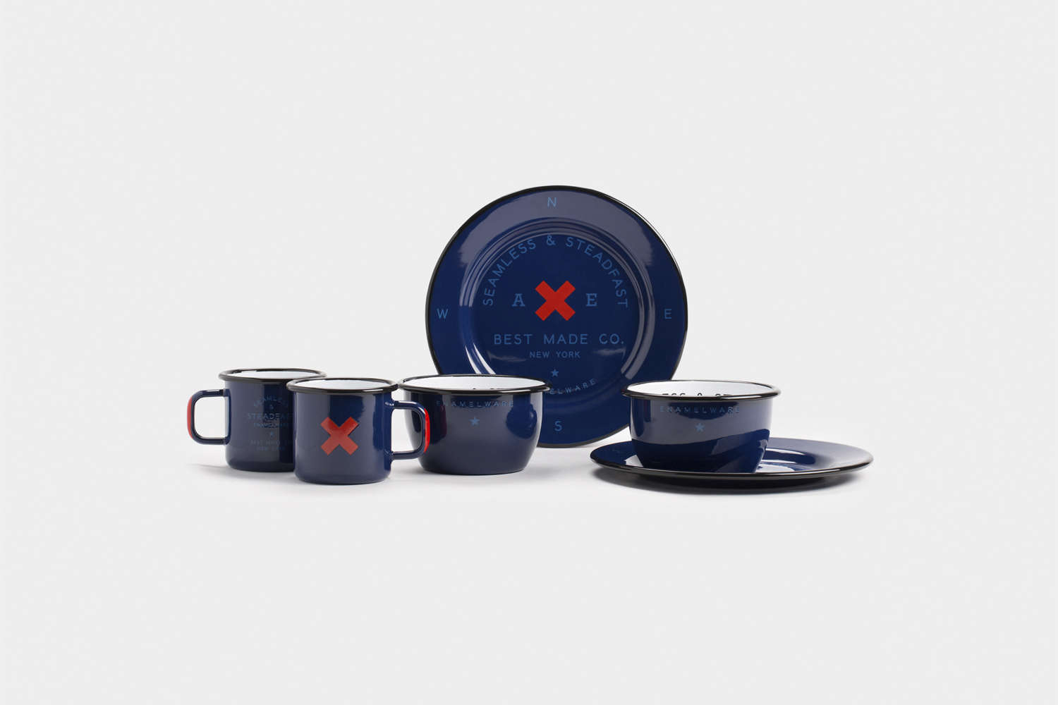 Steal This Look A Stylish Camp Kitchen in a Plywood Summer Cabin The Seamless & Steadfast Enamel Gift Set, shown in navy blue, from Best Made is \$98 for two place setting at Best Made.