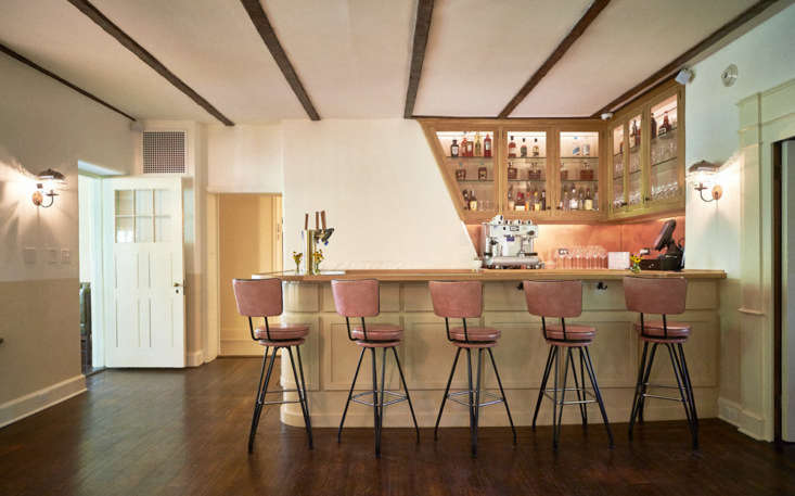 A curved copper bar anchors the all-day bar area.