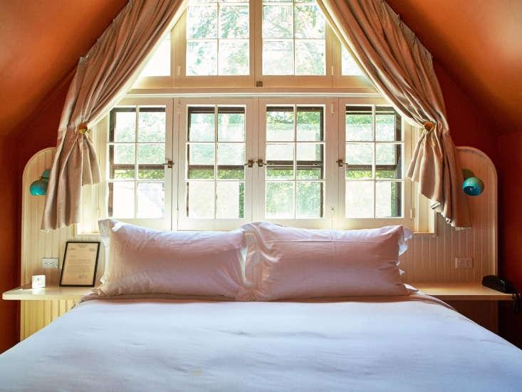 The bedroom overlooks the leafy garden.