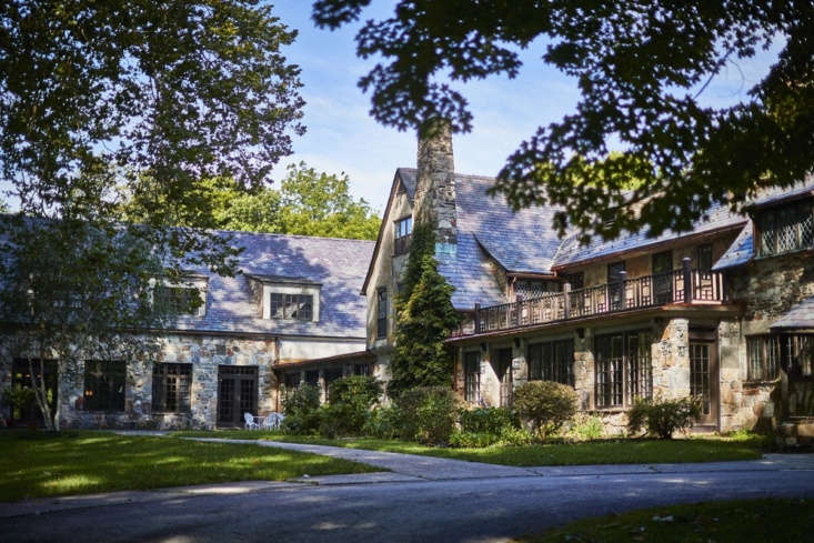 The stone manor house is set on 40 acres; the grounds include two streams, two tennis courts, a pool, and several outbuildings.