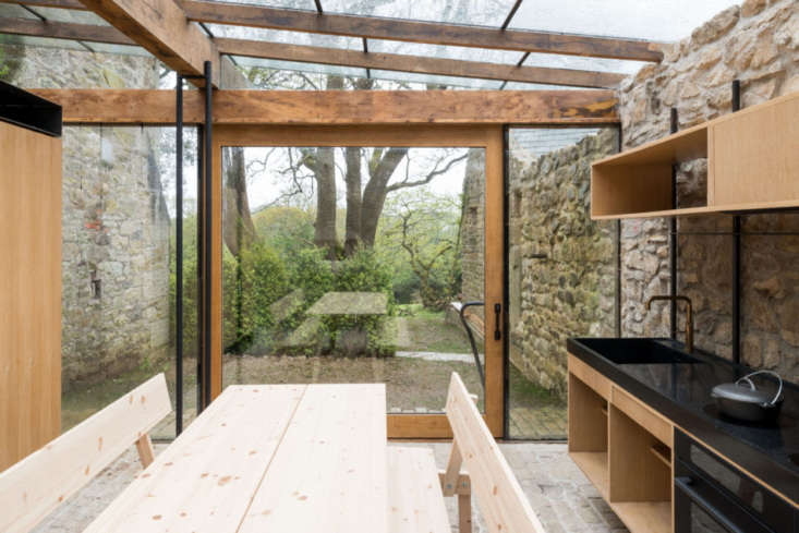 The sliding glass door leads to a secluded area of the garden.