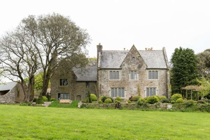 The property is set in the Cornish countryside and includes a 5,000-square-foot main house (shown), as well as three small outbuildings, each of which has been turned into separate guest quarters.